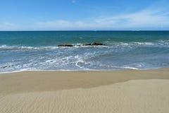 Carribean beach with a bright blue sky. Beach in the Carribean beach and ocean with a bright blue sunny sky royalty free stock photography