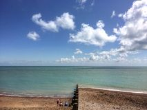 Eastbourne beach. Sunny beach in Eastbourne sky day Royalty Free Stock Image