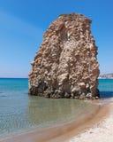 Sunny beach and huge rock Stock Photos