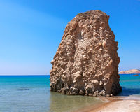 Sunny beach and huge rock Royalty Free Stock Photo