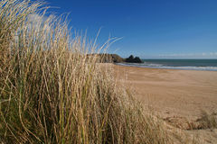 Sunny beach landscape. Three cliff bay in the gower peninsula, south wales, UK stock photo