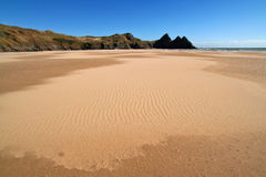 Sunny beach landscape. Three cliff bay in the gower peninsula, south wales, UK royalty free stock photo