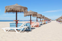 Sunny beach with a line of umbrellas near the sea. S Stock Photo