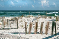 Sunny Beach with Sand Fences and Whitecaps at Florida Beach Royalty Free Stock Photos