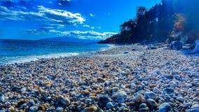 Sunny Beach and Stones royalty free stock photos