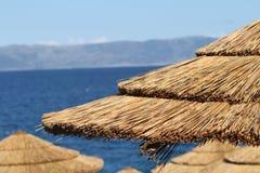 Sunny beach umbrellas. Overlooking the sea Stock Image