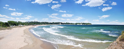 Sunny beach and waves from the top. Panoramic royalty free stock images