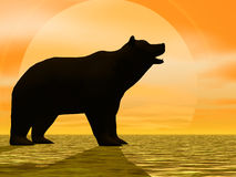 Sunny Bear. Bear Silhouetted by a brigh yellow sun Stock Photo