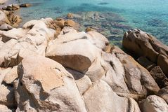 Sunny beautiful summer sea view with Greek blue sea and shallow clear water with small rocks, Halkidiki Greece royalty free stock photos