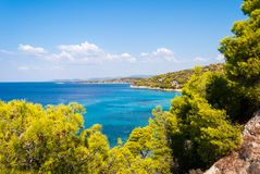 Sunny beautiful summer sea view with Greek blue sea and shallow stock photo