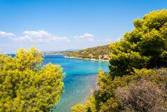 Sunny beautiful summer sea view with Greek blue sea and shallow stock photography