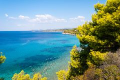 Sunny beautiful summer sea view with Greek blue sea and shallow stock photos