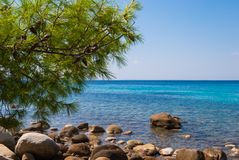 Sunny beautiful summer sea view with Greek blue sea and shallow royalty free stock photo