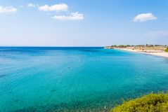 Sunny beautiful summer view of the sandy beach with Greek blue s royalty free stock photography