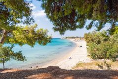Sunny beautiful summer view of the sandy beach with Greek blue s royalty free stock images