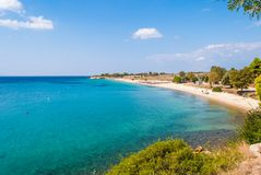 Sunny beautiful summer view of the sandy beach with Greek blue s royalty free stock photos