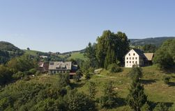 Sunny Black Forest scenery. Idyllic scenery in the Black Forest at summer time with some houses in peaceful ambiance stock images