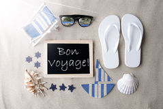 Sunny Blackboard On Sand, Bon Voyage Means Good Trip. Flat Lay Of Chalkboard On Sandy Background. Sunny Summer Decoration As Holiday Greeting Card. Sand And Stock Images