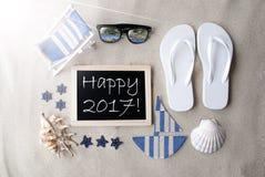 Sunny Blackboard On Sand With-Text glückliches 2017 Stockfotografie