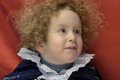Sunny blonde boy. Sunny blonde curly boy smile royalty free stock images