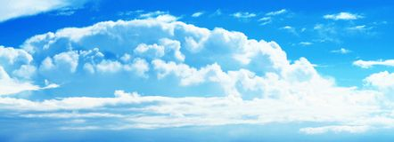 Sunny Blue Cloud Sky. Panoramic view of a cloud formation on a blue, sunny sky royalty free stock images