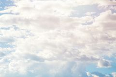 Sunny blue sky background with brush strokes clouds.  Royalty Free Stock Photos