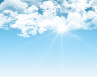 Sunny blue sky. Background with fluffy white clouds Stock Photo