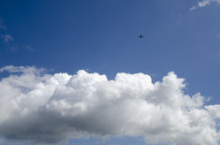 Sunny blue sky and clouds and airplane Stock Image