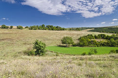 Sunny Blue Sky, Meadow and hills Stock Photo