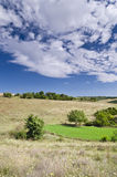 Sunny Blue Sky, Meadow and hills Stock Photography