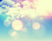 Sunny blue sky with retro effect. Sunny blue sky background with fluffy white clouds and retro effect added Stock Images