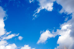 Sunny blue sky. With white clouds in sunny spring day Stock Photography
