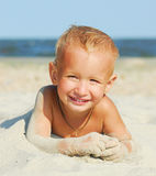Sunny boy. Beautiful young boy smiling under the summer sun Royalty Free Stock Photography