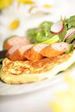 Sunny breakfast. Happy, bright plate of breakfast goodies: omelette, polish kielbasa and a crisp salad Stock Photography