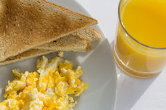 Sunny Breakfast with bacon, eggs and bread. Royalty Free Stock Photo