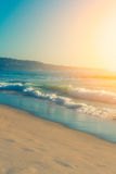 Sunny bright colorful day and wavy ocean Stock Images