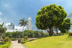 Sunny bright view from Chinese garden in Rizal Luneta park, Manila, Philippines. Sunny bright view from Chinese Japanese garden in Rizal Luneta park, Manila royalty free stock images
