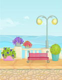 Sunny cartoon seafront landscape, vector seaside background. Stone fence, plants, flowers, benches, paving. Stock Image