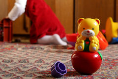 Sunny child's room. Rocking toy bear against a background of a little girl Royalty Free Stock Image