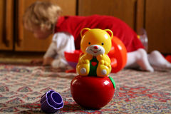Sunny child's room. Rocki bear toy against a background of a little girl Royalty Free Stock Photography