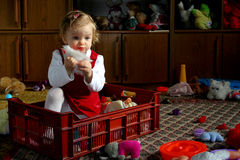 Sunny child's room. Little baby in the toybox Stock Photo