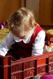 Sunny child's room. Little baby in the toybox Stock Image