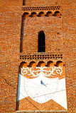 In  the    sunny clock  closed brick tower   italy  lombardy Stock Photo