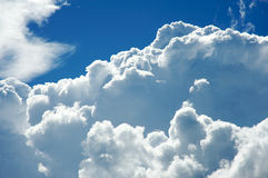 Sunny and cloudy sky Stock Images