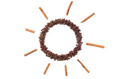 Sunny coffee. Coffee beans stacked in a circle with rays of cinnamon stock photos