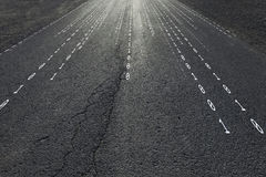 Sunny concept binary code numbers travel background. Concept binary code numbers travel information on black textured sunny asphalt road. Conceptual information royalty free stock image