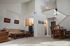 Sunny Condo Living Room. Sunny California townhouse style condo living room.  The wall art (photos) are the photographer's work and are included in the release Royalty Free Stock Photography