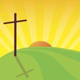 Sunny cross. Landscape of cross on green hill against sunset and radial sunburst background Stock Photos