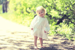 Sunny cute child barefoot in summer day Royalty Free Stock Photos