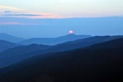 Sunny dawn on the mountain slopes Stock Photo